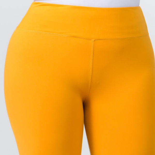 "These plus size New Mix Brand peach skin capris are seamless, chic, and a must-have for every wardrobe. These lightweight, capri leggings have a 3"" waistband. They are versatile, perfect for layering, and available in many colors. 92% Polyester 8% Spandex. One size fits most plus 16-20."