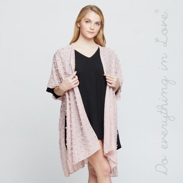 Light weight kimono with bobbles. 100% polyester. Fits most 0-14.