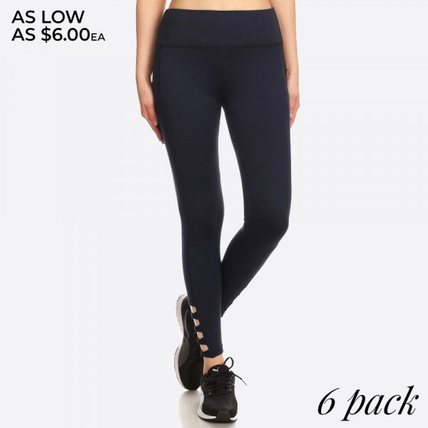 Solid, ankle length fitted activewear leggings with a high banded waist and side ankle cross strap cutouts.