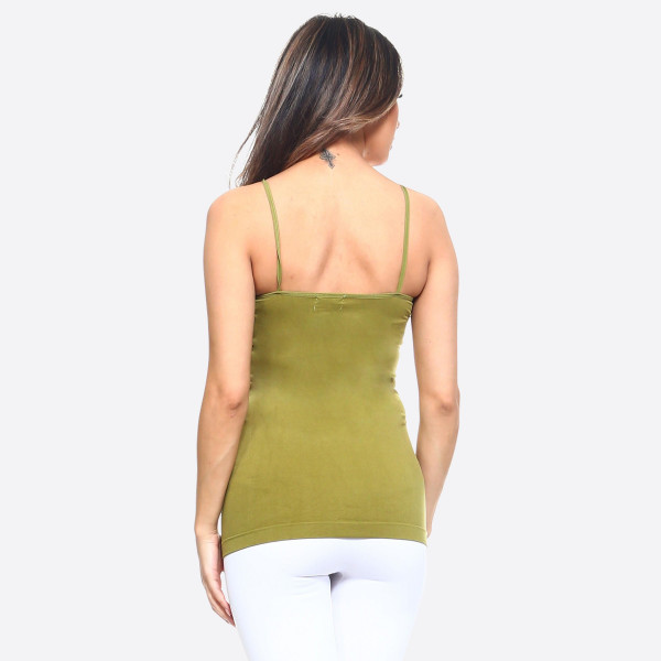 This seamless tank top features spaghetti straps, fade-resistant fabric, soft, and stretchy material. It's great for layering or wearing alone on a hot day.   -Scoop-neck  -Super Soft  -Stretchy  -Machine Wash  -Imported   - One size fits most 0-14  - Content: 92% Nylon, 8% Spandex