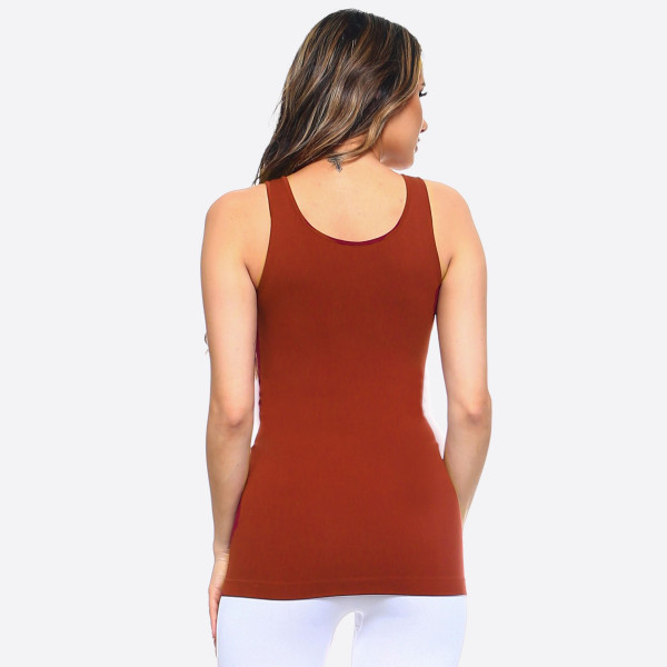 The possibilities are endless with Women's Seamless Tank Top. This basic beauty offers style and comfort for any setting. Rock it bare with a pair of denim jeans for a casual look. Or have fun mixing and matching with patterned cardigans, skater skirts, and wide leg pants for a sassy look.   - Round Neckline  - Body-con  - Sleeveless  - Fitted  - Solid Color  - Super Soft  - Stretchy   One size fits most 0-14. COMPOSITION: 92% Nylon, 8% Spandex