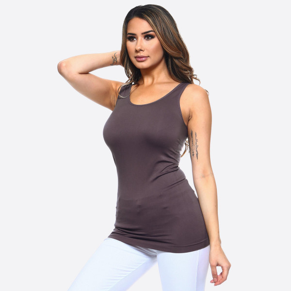 "Solid color seamless tank top.  - Round Neckline  - Body-con  - Sleeveless  - Fitted  - Solid Color  - Super Soft  - Stretchy   - One size fits most 0-14 - Approximately 28"" L - Composition: 92% Nylon, 8% Spandex"