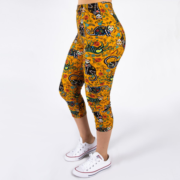 "Peach skin sugar skull cat print capri style leggings. Inseam approximately 19"".  - One size fits most 0-14  - Composition: 92% Polyester, 8% Spandex/Elasthanne"