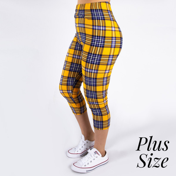 "PLUS SIZE peach skin plaid print capri style leggings. Inseam approximately 19"".  - One size fits most 16-20  - Composition: 92% Polyester, 8% Spandex/Elasthanne"