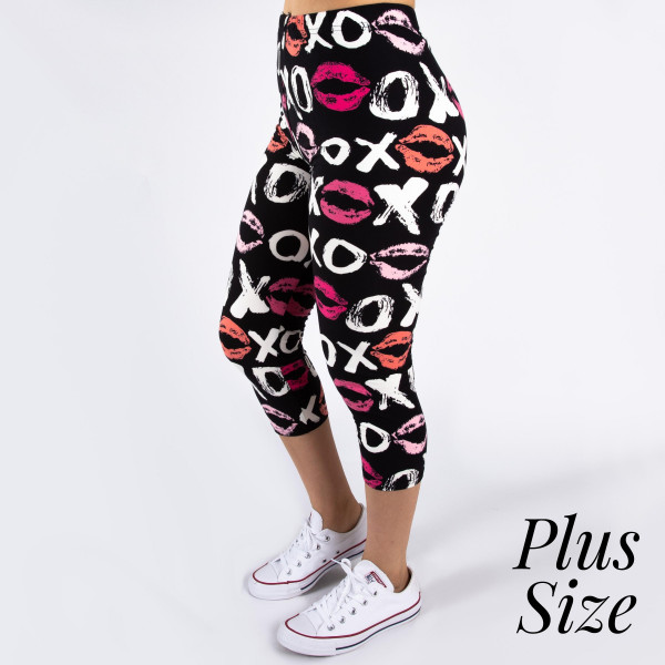 "PLUS SIZE peach skin love print capri style leggings featuring kissy lips and xoxo. Inseam approximately 19"".  - One size fits most 16-20  - Composition: 92% Polyester, 8% Spandex/Elasthanne"