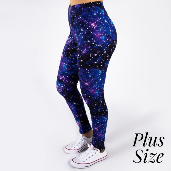 "PLUS SIZE peach skin galaxy print full-length leggings featuring stars, planets and moons. Inseam approximately 26"".  - One size fits most 16-20  - Composition: 92% Polyester, 8% Spandex/Elasthanne"
