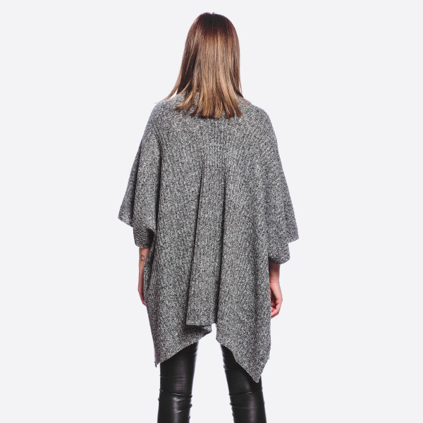 "Heather knit kimono with pocket details.   - One size fits most - Approximately 30"" in length - 100% Acrylic"