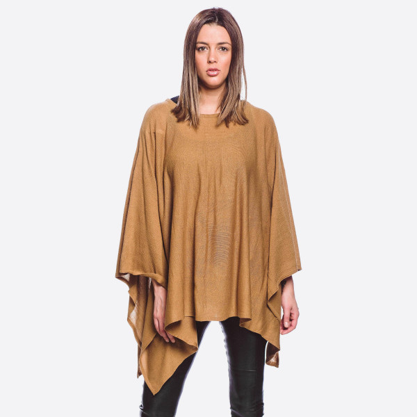 """Lightweight fine knit poncho.  - One size fits most 0-14 - Approximately 23"""" in length, longest length 34""""  - 100% Acrylic"""