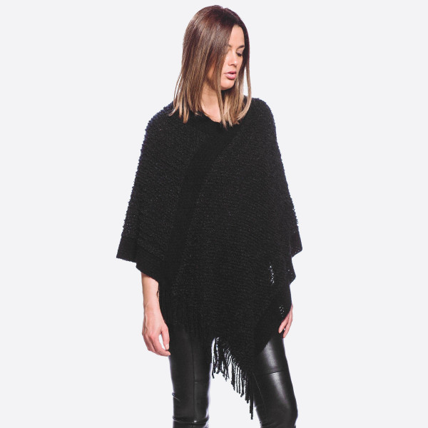 """Popcorn knit poncho with fringes.   - One size fits most 0-14 - Approximately 31"""" in length - 40% Acrylic, 60% Polyester"""