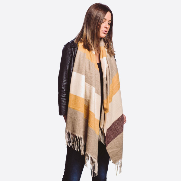 "Oblong color block scarf with fringes.  - One size fits most  - Approximately 84"" L x 24"" W  - Composition: 100% Polyester"