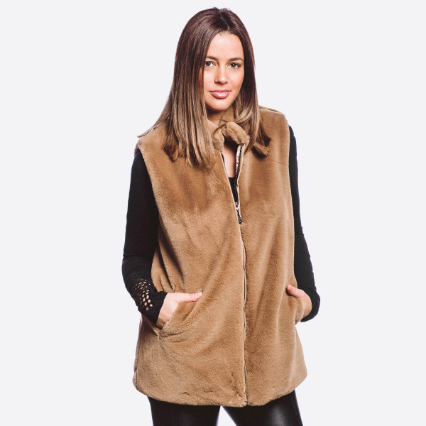 """Faux fur vest with zipper closure and pocket details.  - One size fits most 0-14 - Approximately 29"""" in length - 100% Polyester"""