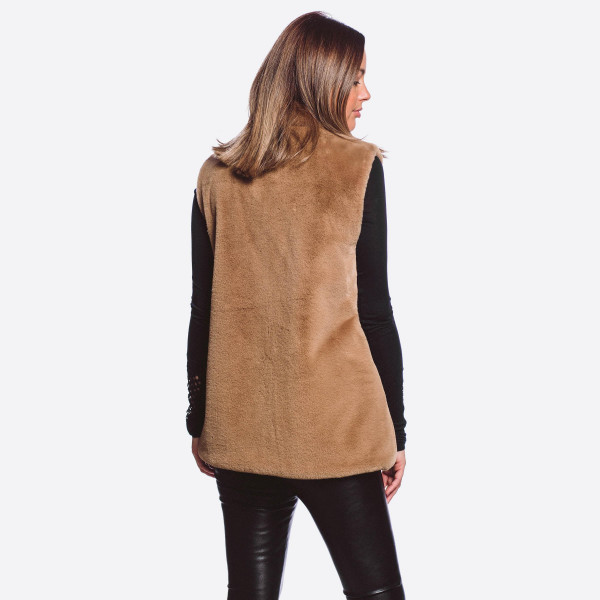 "Faux fur vest with zipper and pocket details.  - One size fits most 0-14 - Approximately 26"" in length - 100% Polyester"