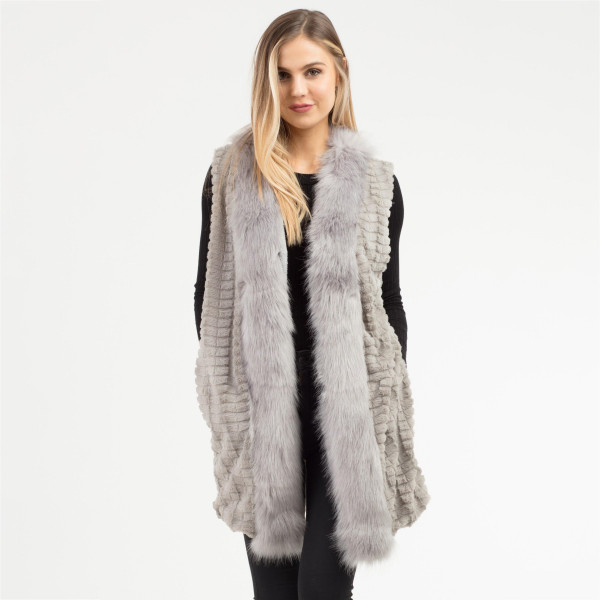 """Soft faux fur trim vest with side pocket details.  - One size fits most - Approximately 31"""" in length - 100% Polyester"""