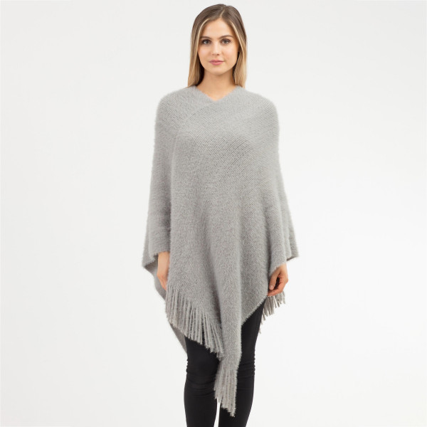 """Soft faux fur poncho with fringes.  - One size fits most 0-14 - Approximately 41"""" in length - 100% Acrylic"""