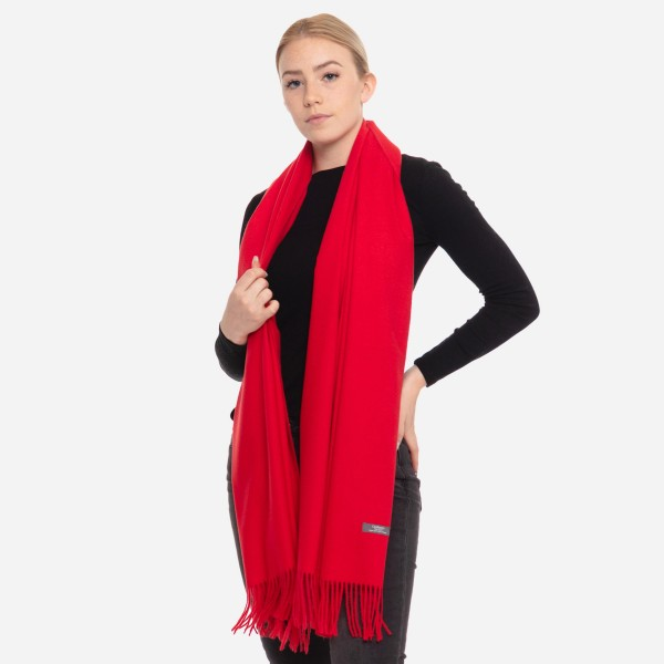 "Solid cashmere feel scarf with fringes.  - Approximately 28"" W x 78"" L - 100% Viscose"