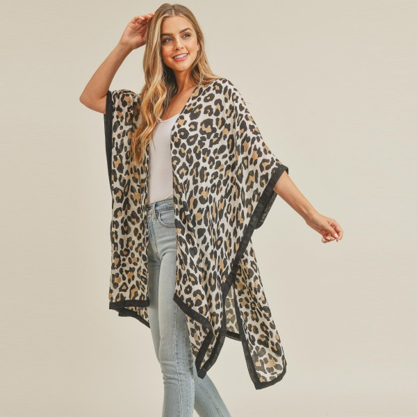 """Lightweight leopard print kimono.  - Approximately 61"""" in length - 100% Polyester"""