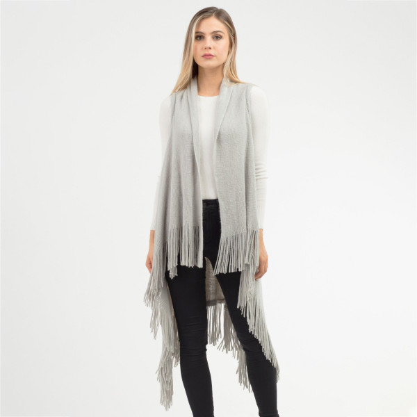 "Solid knit vest with fringes.  - One size fits most 0-14 - Approximately 43"" in length, longest length 47"" - 100% Acrylic"