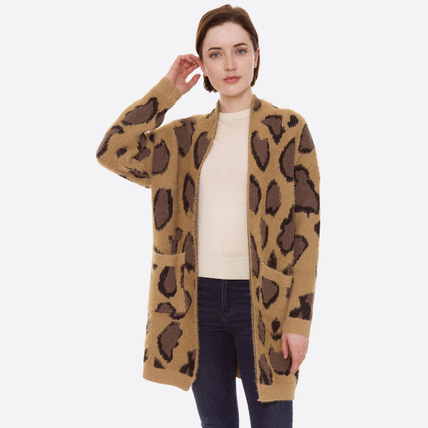 "Soft furry leopard print cardigan with front pocket details.  - One size fits most 0-14 - Approximately 30"" in length - 70% Acrylic, 30% Polyester"