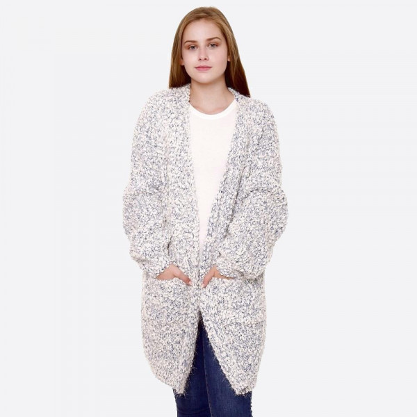 "Mixed popcorn knit cardigan with front pocket details.  - One size fits most 0-14 - Approximately 30"" in length - 85% Acrylic, 15% Polyester"