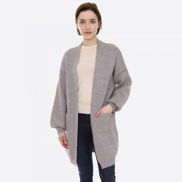 """Solid color knit cardigan with terry cloth balloon sleeves and front pocket details.  - One size fits most 0-14 - Approximately 32"""" in length - 100% Polyester"""