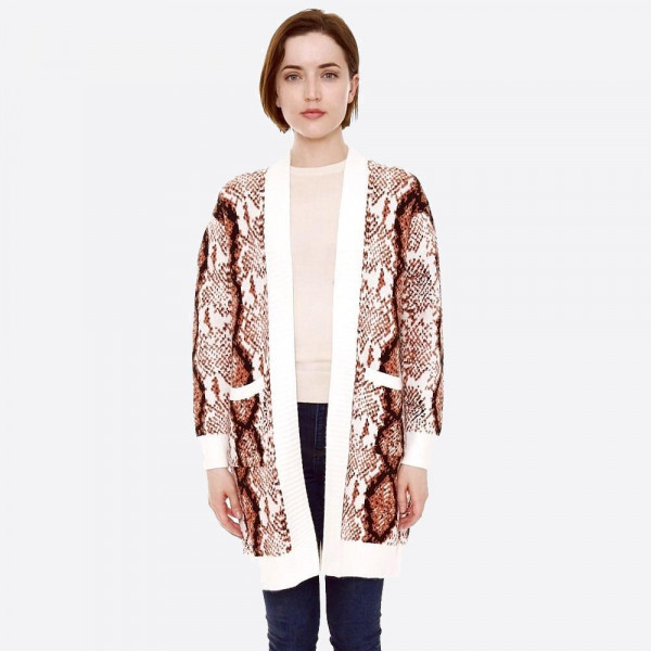 "Snakeskin print cardigan with front pocket details.  - One size fits most - Approximately 34"" in length - 22% Polamide, 28% Polyester, 50% Viscose"