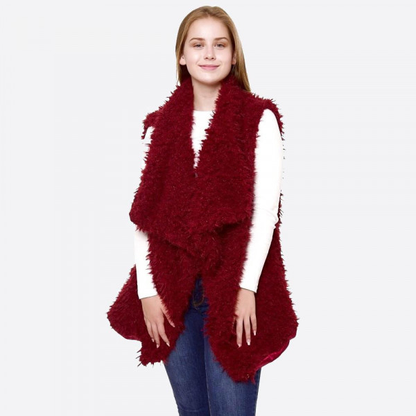 """Faux fur vest.  - One size fits most 0-14 - Approximately 30"""" L  - 100% Polyester"""