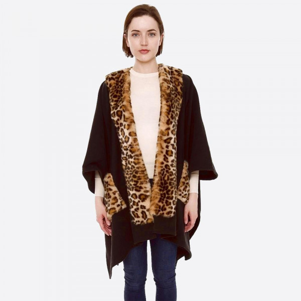 """Faux fur leopard print trim ruana with fur pocket details.  - One size fits most 0-14 - Approximately 30"""" in length - 100% Acrylic"""