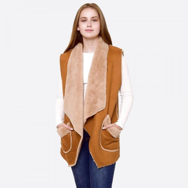 "Faux suede fur lined vest with front pocket details.  - One size fits most 0-14 - Approximately 28"" in length  - 100% Acrylic"