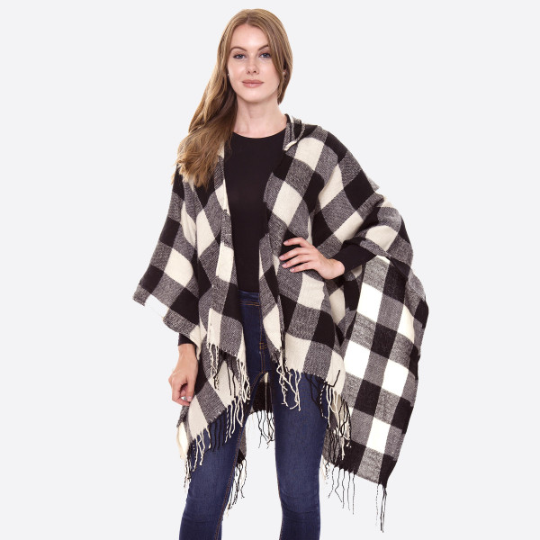 """Hooded buffalo check ruana with fringes.   - One size fits most 0-14 - Approximately 32"""" L - 100% Acrylic"""
