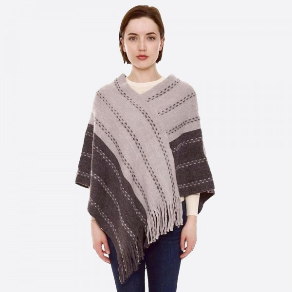 """Two tone whip stitch poncho with fringes.   - One size fits most 0-14 - Approximately 35"""" in length  - 100% Acrylic"""