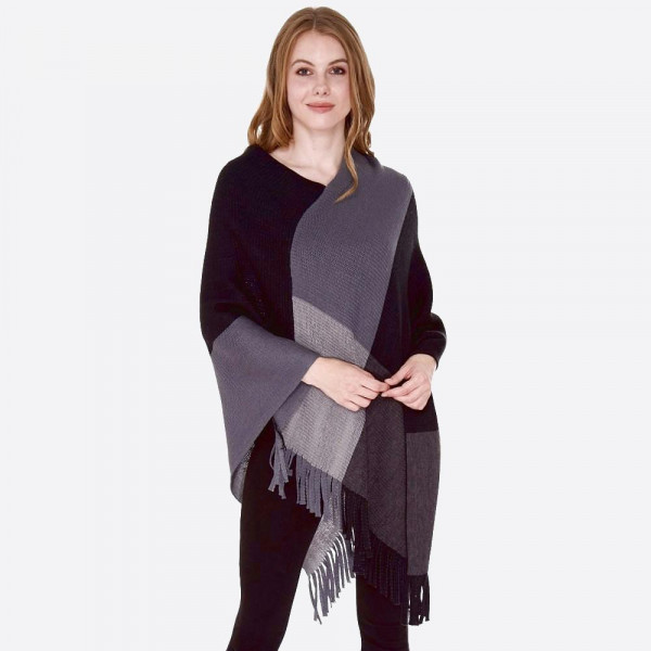 """Color block knit poncho with fringes.  - One size fits most 0-14 - Approximately 36"""" L - 100% Acrylic"""