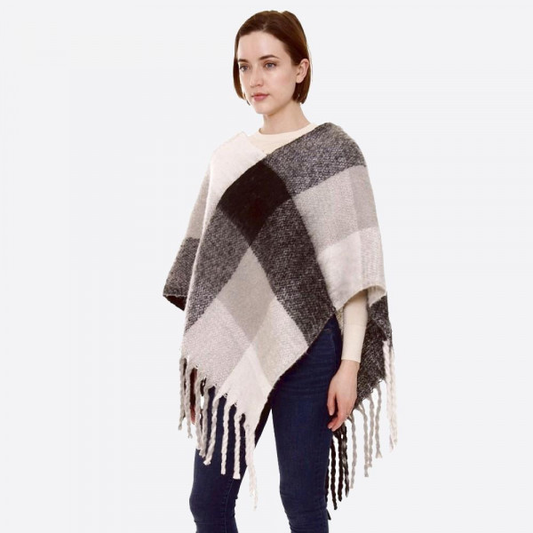 """Soft touch check plaid fuzzy knit poncho with oversized fringes.  - One size fits most 0-14 - Approximately 37"""" in length - 100% Acrylic"""
