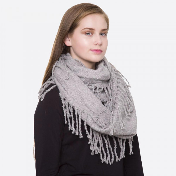 "Solid color knit infinity scarf with fringes.  - Approximately 13"" W x 32"" L - 100% Acrylic"