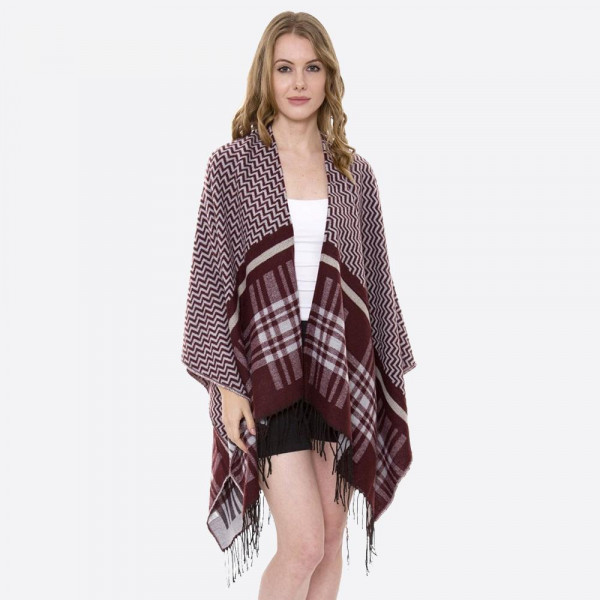 """Zigzag plaid mixed print ruana with fringes.  - One size fits most 0-14 - Approximately 34"""" in length - 100% Acrylic"""
