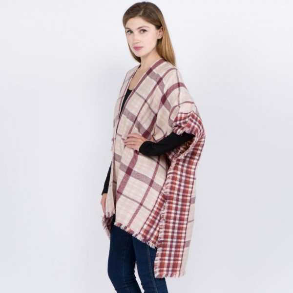 """Plaid print ruana with frayed edges.  - One size fits most 0-14 - Approximately 32"""" L - 100% Acrylic"""