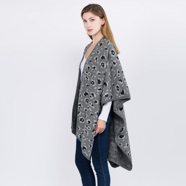 """Leopard print ruana.  - One size fits most 0-14 - Approximately 29"""" L - 60% Acrylic, 40% Polyester"""