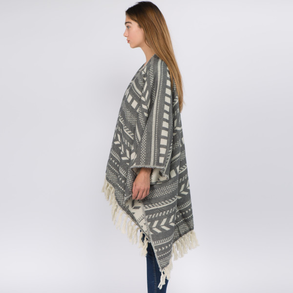 """Tribal print ruana with fringes.  - One size fits most 0-14 - Approximately 34"""" in length - 100% Acrylic"""