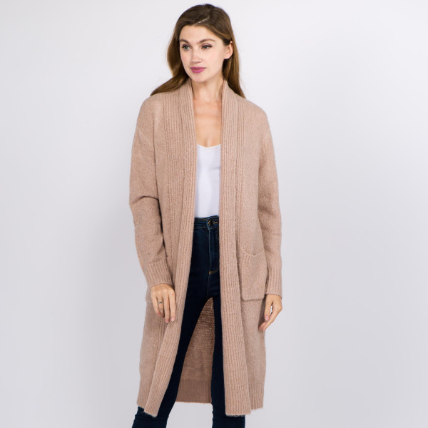 "Long solid color soft touch knit cardigan with front pocket details.  - One size fits most 0-14 - Approximately 36"" in length - 70% Acrylic, 27% Polyamide, 3% Spandex"
