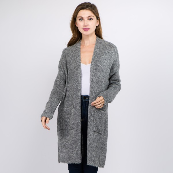 "Solid color soft touch knitted cardigan with front pocket details.  - One size fits most 0-14 - Approximately 35"" in length - 70% Acrylic, 30% Polyamide, 3% Spandex"