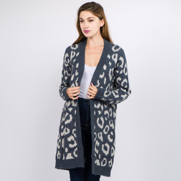 "Soft touch fuzzy leopard print cardigan.  - One size fits most 0-14 - Approximately 33"" in length - 70% Acrylic, 27% Polyamide, 3% Spandex"