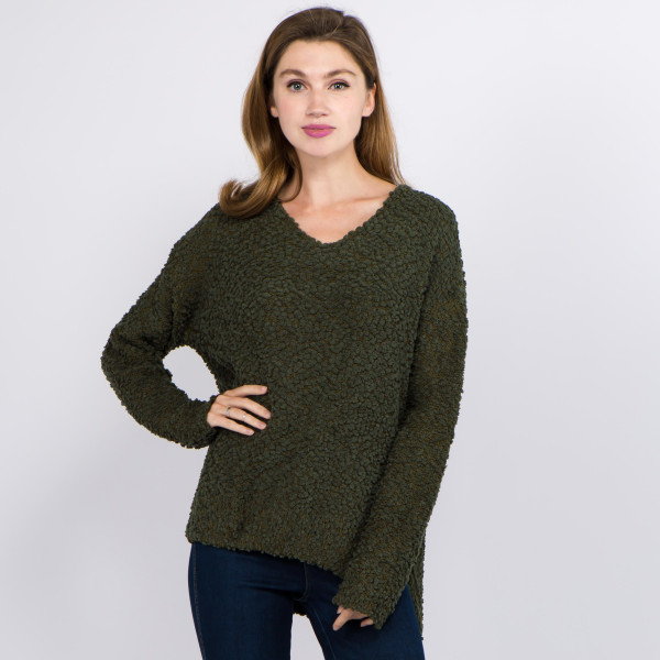 """Solid color v neck popcorn knit sweater with side slit details.  - One size fits most 0-14 - Approximately 25"""" in length - 100% Polyester"""