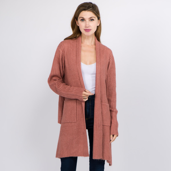 "Solid color ribbed knit cardigan with shark bite hem and pocket details.  - One size fits most 0-14 - Approximately 25"" in back length; front hem 33"" L - 66% Acrylic, 30% Polyester, 4% Spandex"
