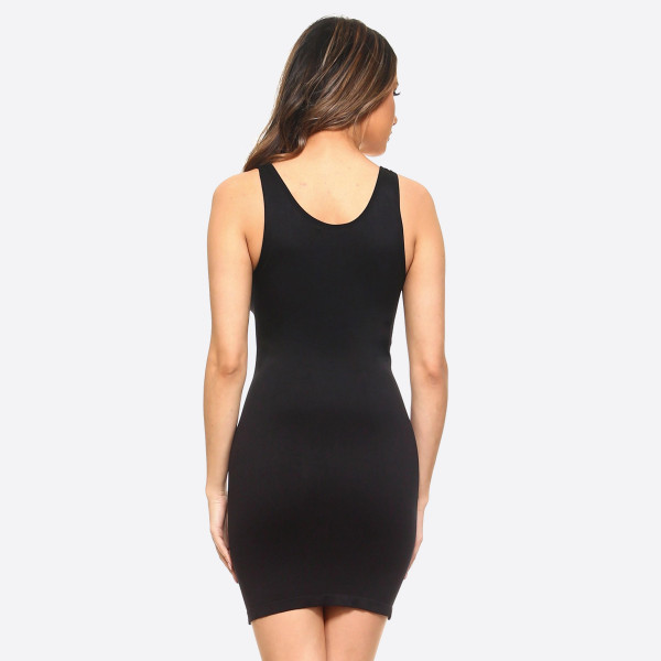 "Solid seamless tank slip dress. Approximately 28.5"" in length.  • Sleeveless  • Scoop neckline  • Fits like a glove  • Soft and stretchy  • Seamless design for comfort  • Short length hem  • Imported   - One size fits most 0-14  - Composition: 92% Nylon, 8% Spandex"
