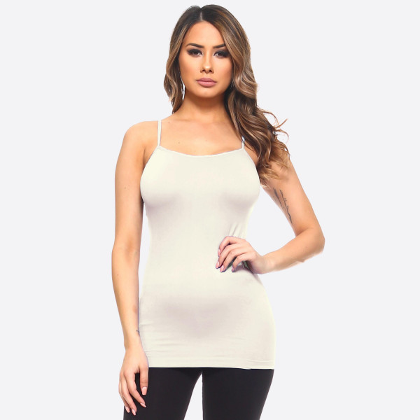 "Solid seamless cami tank top. Approximately 18"" in length.  • Spaghetti straps  • Seamless design for extra comfort  • Longline hem  • Soft and stretchy  • Fits like a glove  • Perfect for layering under sheer tops or by itself  • Imported   - One size fits most 0-14  - Composition: 92% Nylon, 8% Spandex"