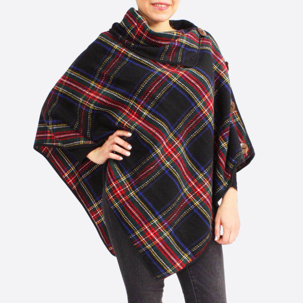 "Tartan poncho with coconut button details.  - One size fits most 0-14 - Approximately 31"" in length - 100% Polyester"