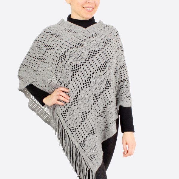"Crochet inspired knit poncho with fringes.  - One size fits most 0-14 - Approximately 35"" in length - 100% Acrylic"