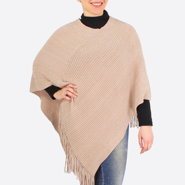 """Chenille poncho with fringes.  - One size fits most 0-14 - Approximately 36"""" in length - 100% Polyester"""