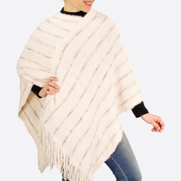 """Furry knit poncho with fringes.  - One size fits most 0-14 - Approximately 37"""" in length - 100% Acrylic"""