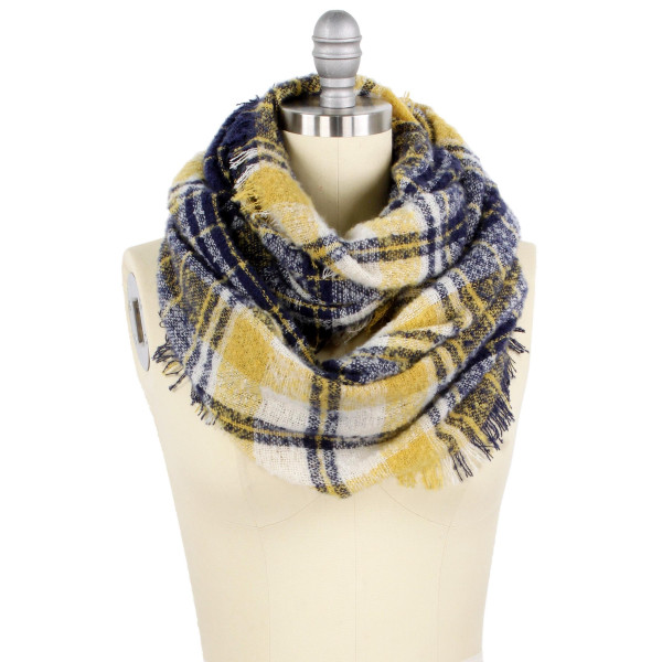 """Plaid pattern wide infinity scarf.  - Approximately 25.5"""" W x 33.5"""" L - 100% Polyester"""