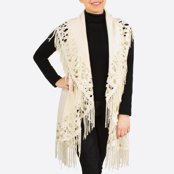 """Round knit vest with fringes.  - One size fits most 0-14 - Approximately 43"""" in length - 100% Acrylic"""